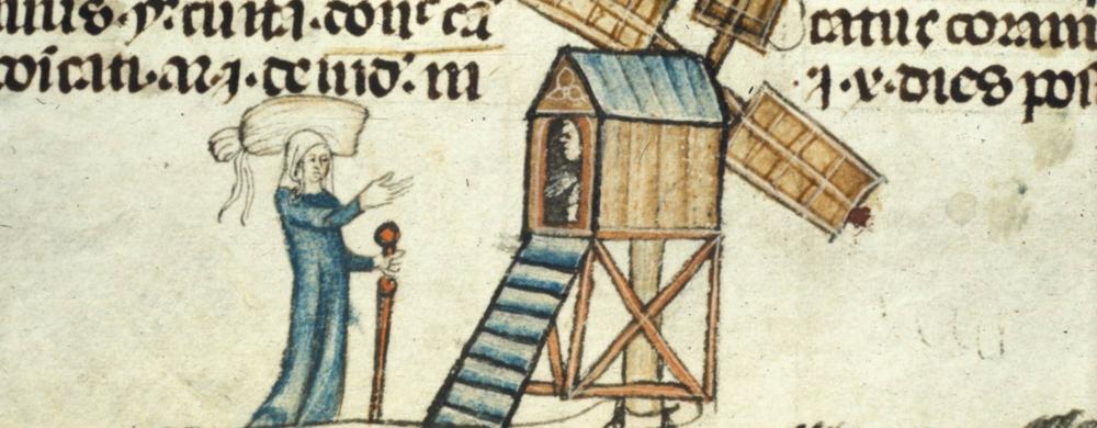 Woman approaching a windmill